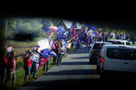 Supporters of President Donald Trump line the road as the motorcade with Democratic presidential candidate former Vice President Joe Biden arrives at Gettysburg National Military Park in Gettysburg, Pa., Tuesday, Oct. 6, 2020. (AP Photo/Andrew Harnik)