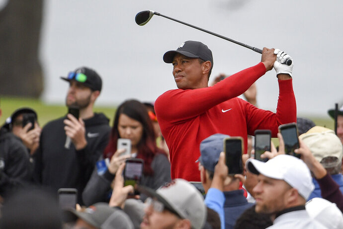 FILE - In Jan. 26, 2020, file photo, Tiger Woods watches his tee shot on the second hole of the South Course at Torrey Pines Golf Course during the final round of the Farmers Insurance golf tournament Sunday,, in San Diego. Riviera is where Tiger Woods played his first PGA Tour event as an amateur. It would be the ideal place to set the tour record for most wins. (AP Photo/Denis Poroy, File)