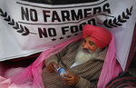 FILE - In this Monday, Dec. 14, 2020, file photo, a protesting farmer rests on his tractor trailer blocking a highway with other farmers at the Delhi- Haryana border, on the outskirts of New Delhi, India. Relations between Twitter and Modi's government have gone downhill ever since a tweet by pop star Rihanna in February sparked widespread condemnation of Indian Prime Minister Narendra Modi's handling of massive farmer protests near the capital. At the heart of the standoff is a sweeping internet law that puts digital platforms like Twitter and Facebook under direct government oversight. Critics of the law worry it may lead to outright censorship in a country where digital freedoms have been shrinking since Modi took office in 2014. (AP Photo/Manish Swarup, File)