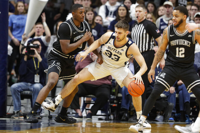 Butler forward Bryce Golden (33) drives on Providence forward Kalif Young (13) in the second half of an NCAA college basketball game in Indianapolis, Saturday, Feb. 1, 2020. Providence defeated Butler 65-61. (AP Photo/Michael Conroy)