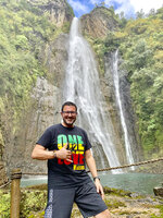 In this photo provided by Wissam Ali-Ahmad, Ali-Ahmad uses his phone to pose for a photo on Nov. 19, 2020, in Hanapepe, Hawaii. A group of Hawaii leaders is trying to attract more people like Ali-Ahmad to work remotely in Hawaii during the pandemic. (Wissam Ali-Ahmad via AP)