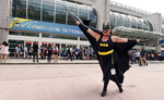 Faeren Adams of San Diego, dressed as Batgirl, strikes a pose outside the San Diego Convention Center during Preview Night of the 2019 Comic-Con International: San Diego, Wednesday, July 17, 2019, in San Diego. (Photo by Chris Pizzello/Invision/AP)