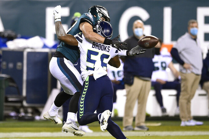 Philadelphia Eagles' Dallas Goedert, left, cannot catch a pass against Seattle Seahawks' Jordyn Brooks during the second half of an NFL football game, Monday, Nov. 30, 2020, in Philadelphia. Brooks was penalized for pass interference on the play. (AP Photo/Derik Hamilton)