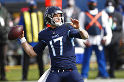 Tennessee Titans quarterback Ryan Tannehill passes against the Baltimore Ravens in the first half of an NFL wild-card playoff football game Sunday, Jan. 10, 2021, in Nashville, Tenn. (AP Photo/Wade Payne)