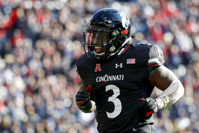 Cincinnati running back Michael Warren II celebrates after scoring a touchdown in the first half of an NCAA college football game against Navy, Saturday, Nov. 3, 2018, in Cincinnati. (AP Photo/John Minchillo)