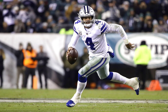 FILE - In this Nov. 11, 2018, file photo, Dallas Cowboys quarterback Dak Prescott looks to pass against the Philadelphia Eagles during the second half of an NFL football game, in Philadelphia. The Los Angeles Rams and Cowboys meet in a divisional playoff game on Saturday, Jan. 12, 2019.(AP Photo/Matt Rourke, File)