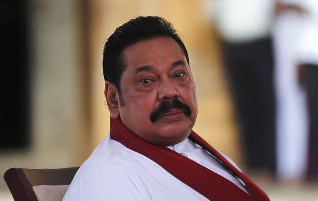 Sri Lanka's former President Mahinda Rajapaksa, waits to be sworn in as the prime minister at Kelaniya Royal Buddhist temple in Colombo, Sri Lanka, Sunday, Aug. 9, 2020. (AP Photo/Eranga Jayawardena)