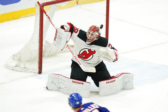 New Jersey Devils goaltender Mackenzie Blackwood (29) stops a shot on goal during the second period of an NHL hockey game against the New York Islanders Saturday, May 8, 2021, in Uniondale, N.Y. (AP Photo/Frank Franklin II)