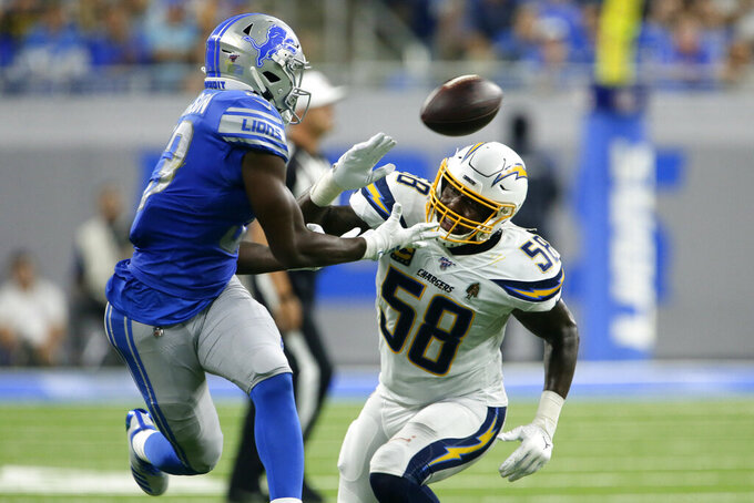 Los Angeles Chargers outside linebacker Thomas Davis (58) defends Detroit Lions running back Kerryon Johnson (33) in pass coverage in the first half of an NFL football game in Detroit, Sunday, Sept. 15, 2019. The pass was incomplete. (AP Photo/Duane Burleson)