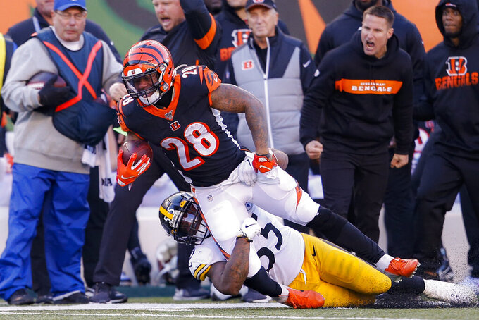 Cincinnati Bengals running back Joe Mixon (28) is tackled on the run by Pittsburgh Steelers linebacker Devin Bush (55) during the second half an NFL football game, Sunday, Nov. 24, 2019, in Cincinnati. (AP Photo/Gary Landers)