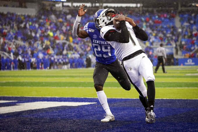 Louisville wide receiver Tutu Atwell (1) catches a touchdown pass during the first half of the NCAA college football game against Kentucky, Saturday, Nov. 30, 2019, in Lexington, Ky. (AP Photo/Bryan Woolston)