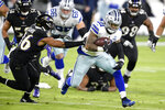 Dallas Cowboys running back Ezekiel Elliott, right, runs with the ball as Baltimore Ravens strong safety Chuck Clark tries to bring him down during the first half of an NFL football game, Tuesday, Dec. 8, 2020, in Baltimore. (AP Photo/Nick Wass)
