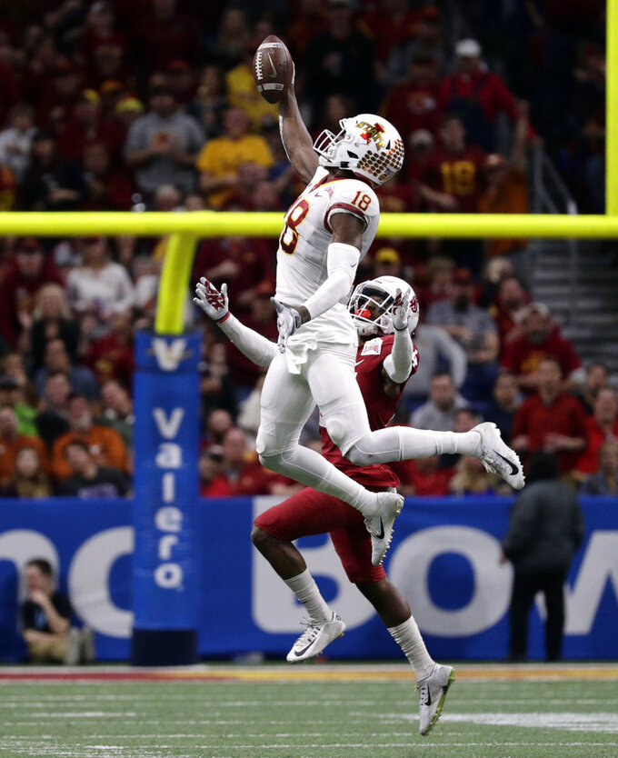 Iowa State wide receiver Hakeem Butler (18) makes a catch over Washington State safety Jalen Thompson during the second half of the Alamo Bowl NCAA college football game, Friday, Dec. 28, 2018, in San Antonio. (AP Photo/Eric Gay)