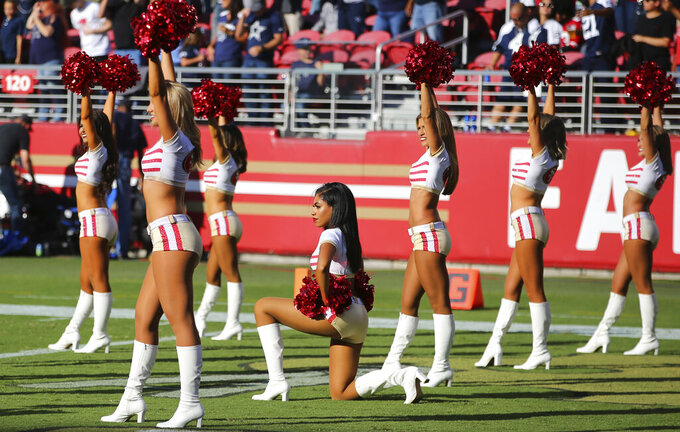 A San Francisco 49ers cheerleader kneels during the national anthem before an NFL preseason football game between the 49ers and the Dallas Cowboys in Santa Clara, Calif., Saturday, Aug. 10, 2019. (AP Photo/John Hefti)