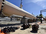 FILE - In this June 8, 2017, file photo, fresh nuts, bolts and fittings are ready to be added to the east leg of the Enbridge Line 5 pipeline near St. Ignace, Mich., as Enbridge prepares to test the east and west sides of the Line 5 pipeline under the Straits of Mackinac in Mackinaw City, Mich. A Michigan regulatory panel refused Tuesday, June 30, 2020, to grant quick permission to run a new oil pipeline beneath a channel that connects two of the Great Lakes, deciding instead to conduct a full review.Enbridge filed an application in April with the Michigan Public Service Commission to relocate a segment of its Line 5 that extends beneath the Straits of Mackinac, which links Lakes Huron and Michigan.(Dale G. Young/Detroit News via AP, File)