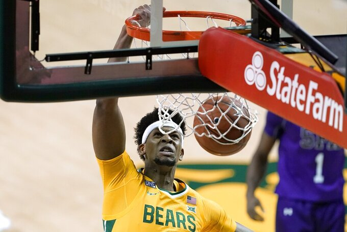 Baylor forward Flo Thamba (0) dunks the ball in the second half of an NCAA college basketball game against Stephen F. Austin in Waco, Texas, Wednesday, Dec. 9, 2020. (AP Photo/Tony Gutierrez)