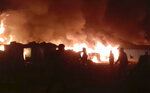 This frame grab from video shows flames rising after a fire broke out in Nayapara Camp in Cox's Bazar district, Bangladesh, Thursday, Jan. 14, 2021. A fire raced through a sprawling Rohingya refugee camp in southern Bangladesh on Thursday, destroying hundreds of homes, officials said. No casualties were reported. The UNHCR said more than 550 homes sheltering about 3,500 people as well as 150 shops were either totally or partially destroyed in the fire.  (AP Photo)