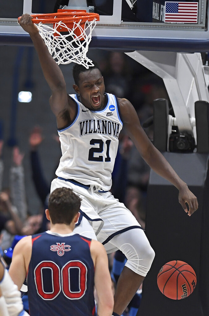 Villanova's Dhamir Cosby-Roundtree (21) reacts after dunking as St. Mary's Tanner Krebs (00) looks on during the second half of a first round men's college basketball game in the NCAA tournament, Thursday, March 21, 2019, in Hartford, Conn. (AP Photo/Jessica Hill)