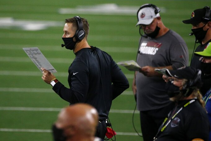 Arizona Cardinals head coach Kliff Kingsbury watches play against the Dallas Cowboys in the second half of an NFL football game in Arlington, Texas, Monday, Oct. 19, 2020. (AP Photo/Michael Ainsworth)