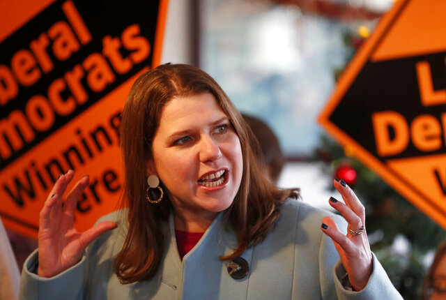 British opposition Liberal Democrats Party Leader Jo Swinson speaks as she joins activists for a final day election rally in Guildford, England, Wednesday, Dec. 11, 2019 during the General Election campaign tour. Britain goes to the polls on Dec. 12.(AP Photo/Frank Augstein)