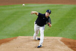 New York Yankees non-roster invitee Clarke Schmidt delivers during the first inning of an intrasquad baseball game Monday, July 6, 2020, at Yankee Stadium in New York. (AP Photo/Kathy Willens)