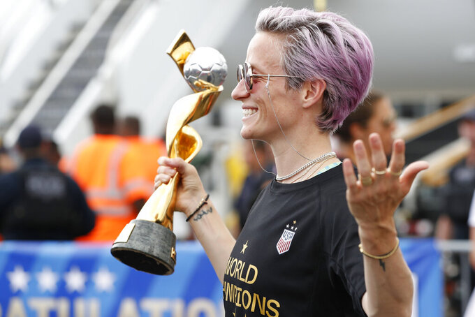 US Women's World Cup champs arrive home ahead of parade