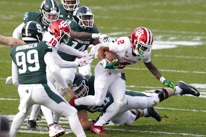 Indiana's Reese Taylor (2) returns a kickoff during the second half of an NCAA college football game against Michigan State, Saturday, Nov. 14, 2020, in East Lansing, Mich. (AP Photo/Carlos Osorio)