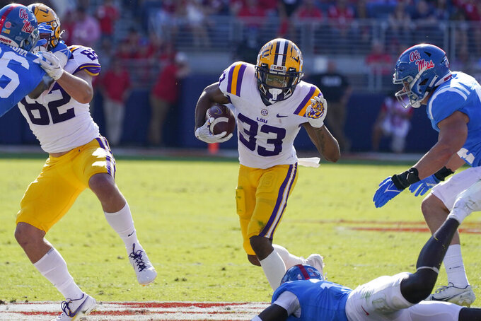 LSU wide receiver Trey Palmer (33) rushes for short yardage against Mississippi during the first half of an NCAA college football game in Oxford, Miss., Saturday, Oct. 23, 2021. (AP Photo/Rogelio V. Solis)