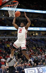 Wisconsin's Trevor Anderson (12) goes up for a basket during the second half of an NCAA college basketball game against Nebraska in the quarterfinals of the Big Ten Conference tournament, Friday, March 15, 2019, in Chicago. (AP Photo/Nam Y. Huh)