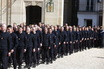 Emergency service personnel walk at the Elysee Palace in Paris after a meeting with French President Emmanuel Macron, Thursday, April 18, 2019. Nearly $1 billion has poured in from ordinary worshippers and high-powered magnates around the world to restore Notre Dame Cathedral in Paris after a massive fire. (AP Photo/Thibault Camus)