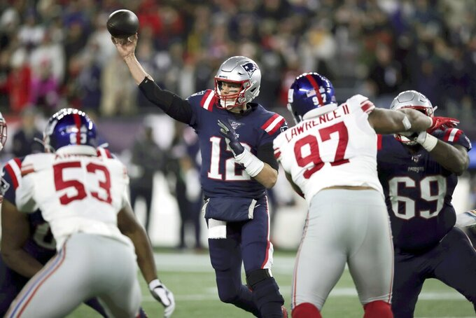 CORRECTS THAT THIS WAS NOT THE PASS THAT MOVED BRADY INTO SECOND PLACE FOR PASSING YARDS - New England Patriots quarterback Tom Brady throws a pass against the New York Giants during the first half of an NFL football game Thursday, Oct. 10, 2019, in Foxborough, Mass. An earlier completion gave Brady the second most total passing yards in NFL history. (AP Photo/Charles Krupa)