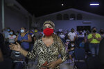 Women wearing masks to curb the spread of the new coronavirus pray during the afternoon service at Bethel evangelical church in Managua, Nicaragua, Wednesday, Aug. 12, 2020. The congregation knows the pandemic's wrath: two of its pastors were among the more than 40 evangelical leaders who have died in Nicaragua since March.  (AP Photo/Alfredo Zuniga)