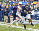 Notre Dame wide receiver Chase Claypool (83) is pushed out-of-bounds by Syracuse defensive back Andre Cisco (19) during the first half of an NCAA college football game, Saturday, Nov. 17, 2018, at Yankee Stadium in New York. (AP Photo/Howard Simmons)