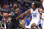Memphis' forward Precious Achiuwa (55) defends Cincinnati's forward Tre Scott (13) in the first half of an NCAA college basketball game Thursday, Jan. 16, 2020, in Memphis, Tenn. (AP Photo/Karen Pulfer Focht)