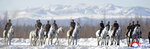 This undated photo provided on Wednesday, Dec. 4, 2019, by the North Korean government shows North Korean leader Kim Jong Un, center,  riding on a white horse during his visit to Mount Paektu, North Korea. North Korea says leader Kim has taken a second ride on a white horse to a sacred mountain in less than two months. Independent journalists were not given access to cover the event depicted in this image distributed by the North Korean government. The content of this image is as provided and cannot be independently verified. Korean language watermark on image as provided by source reads: