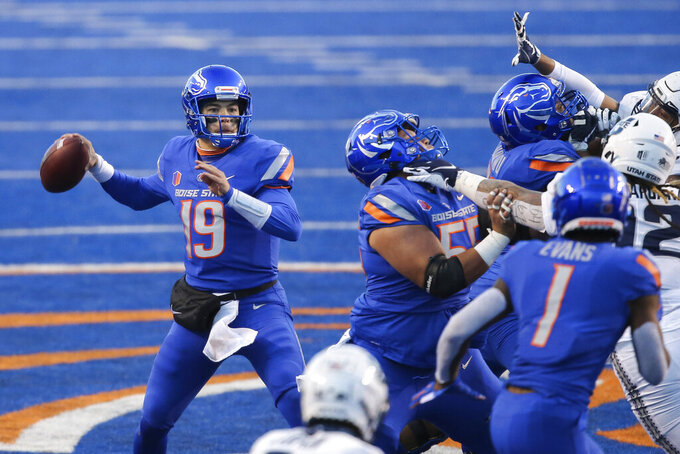 Boise State quarterback Hank Bachmeier (19) looks to throw the ball against the Utah State defense in the first half of an NCAA college football game Saturday, Oct. 24, 2020, in Boise, Idaho. (AP Photo/Steve Conner)