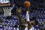 Baylor forward Jonathan Tchamwa Tchatchoua (23) tries to defend against a shot by TCU guard Mike Miles (1) in the first half of an NCAA college basketball game, Saturday, Jan. 9, 2021, in Fort Worth, Texas. (AP Photo/ Richard W. Rodriguez)