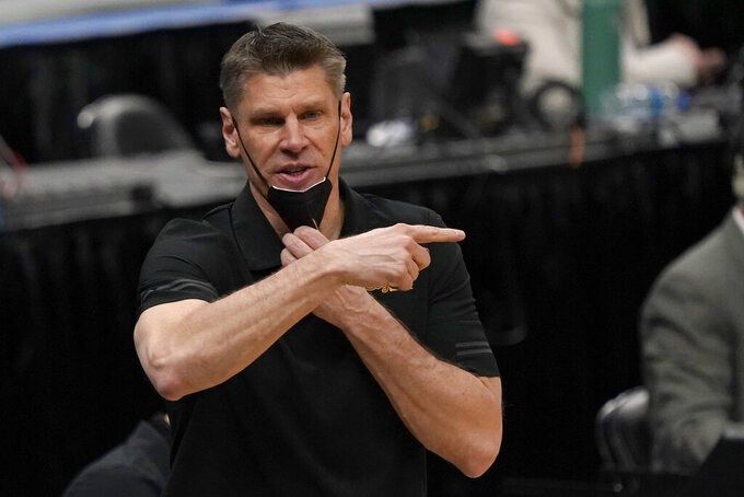 Loyola of Chicago head coach Porter Moser is seen on the sidelines during the second half of an NCAA college basketball game against Southern Illinois in the quarterfinal round of the Missouri Valley Conference men's tournament Friday, March 5, 2021, in St. Louis. (AP Photo/Jeff Roberson)