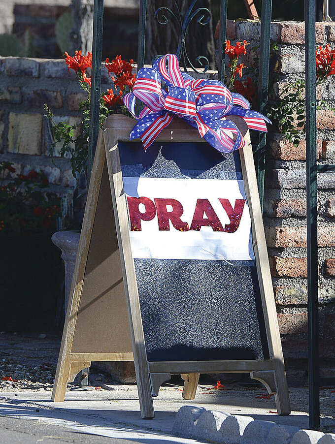 A sign is displayed in front of residences and at the front gate to Coyote Ranch, during the COVID-19 pandemic, in Yuma, Ariz., Sunday, March 29, 2020.  (Randy Hoeft/The Yuma Sun via AP)