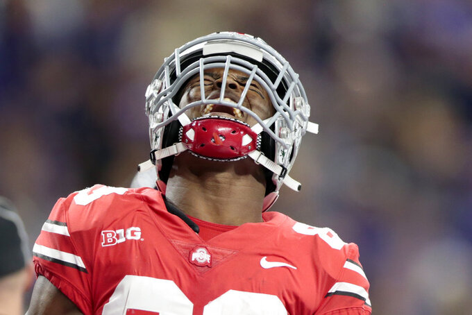 Ohio State wide receiver Terry McLaurin celebrates after catching a touchdown pass during the first half of the Big Ten championship NCAA college football game against Northwestern, Saturday, Dec. 1, 2018, in Indianapolis. (AP Photo/AJ Mast)