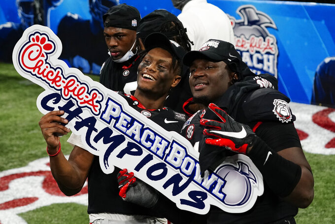 Georgia players celebrate victory over Cincinnati after the Peach Bowl NCAA college football game, Friday, Jan. 1, 2021, in Atlanta. Georgia won 22-21. (AP Photo/Brynn Anderson)