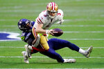 San Francisco 49ers quarterback C.J. Beathard (3) is sacked by Seattle Seahawks safety Ugo Amadi (28) during the first half of an NFL football game, Sunday, Jan. 3, 2021, in Glendale, Ariz. (AP Photo/Ross D. Franklin)