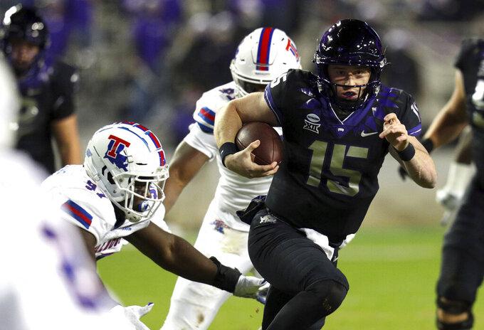 TCU quarterback Max Duggan (15) carries the ball against Louisiana Tech in the first half during an NCAA college football game, Saturday, Dec. 12, 2020. (AP Photo/Richard W. Rodriguez)