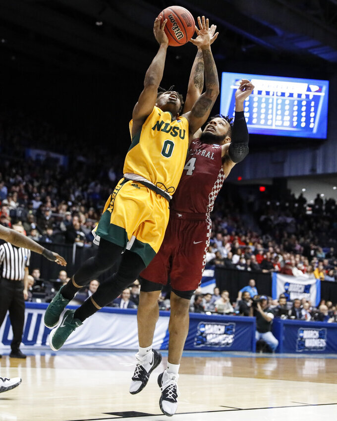 North Dakota State's Vinnie Shahid (0) shoots against North Carolina Central's Jordan Perkins (4) during the second half of a First Four game of the NCAA men's college basketball tournament Wednesday, March 20, 2019, in Dayton, Ohio. (AP Photo/John Minchillo)