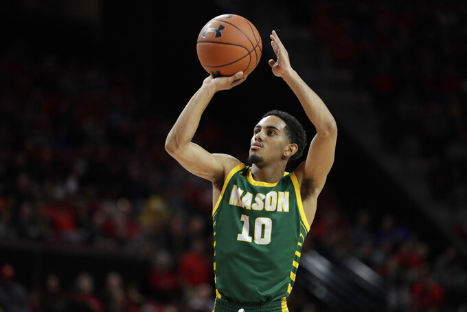 George Mason guard Jamal Hartwell II shoots a free throw against Maryland during the first half of an NCAA college basketball game Friday, Nov. 22, 2019, in College Park, Md. (AP Photo/Julio Cortez)