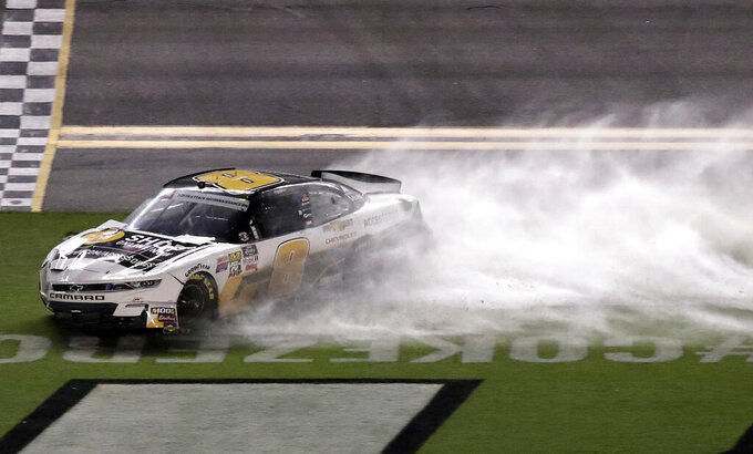 After getting caught up in a minor crash, Sheldon Creed (8) slides through a rain-soaked infield during a NASCAR Xfinity Series auto race at Daytona International Speedway, Friday, July 5, 2019, in Daytona Beach, Fla. (AP Photo/John Raoux)