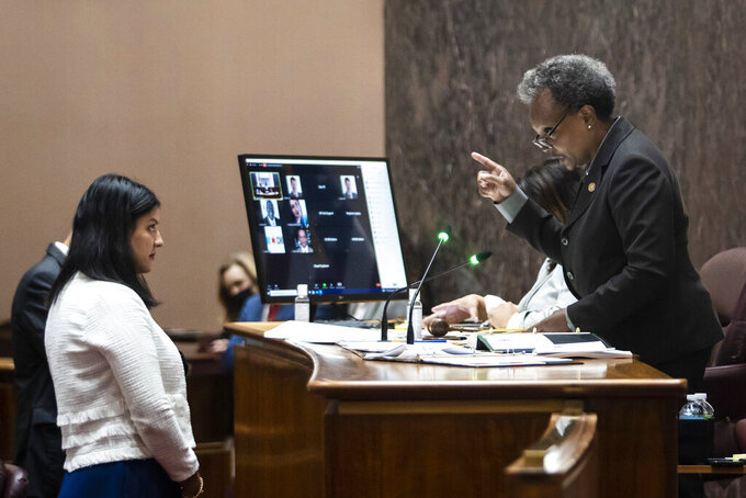 Mayor Lori Lightfoot right, reads the vote tally for a proposal for civilian oversight of the Chicago Police Department during a Chicago City Council meeting at City Hall, Wednesday, July 21, 2021. (Ashlee Rezin/Chicago Sun-Times via AP)