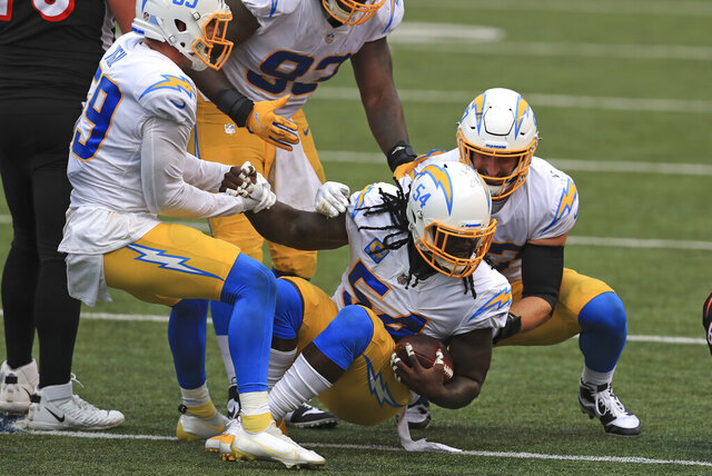 Los Angeles Chargers defensive end Melvin Ingram (54) celebrates after making an interception during the second half of an NFL football game against the Cincinnati Bengals, Sunday, Sept. 13, 2020, in Cincinnati. (AP Photo/Aaron Doster)