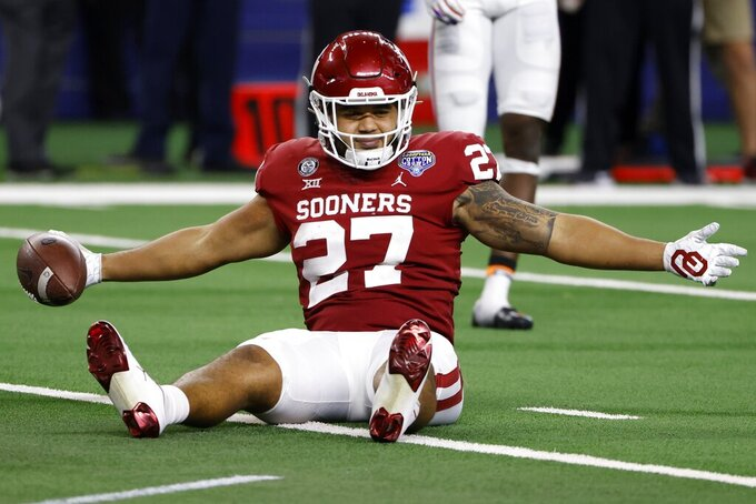 Oklahoma tight end Jeremiah Hall celebrates after catching a pass inside the 5-yard line during the second half of the team's Cotton Bowl NCAA college football game against Florida in Arlington, Texas, Wednesday, Dec. 30, 2020. (AP Photo/Ron Jenkins)