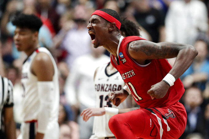 Texas Tech forward Tariq Owens celebrates after a blocked shot against Gonzaga during the second half of the West Regional final in the NCAA men's college basketball tournament Saturday, March 30, 2019, in Anaheim, Calif. Texas Tech won 75-69. (AP Photo/Jae C. Hong)